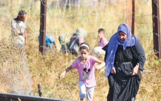 Hele verden, heriblandt kurdere tier over for massakren i Rojava