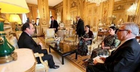 To kurdiske kvinder i Paris hos L'Humanité og præsident Hollande